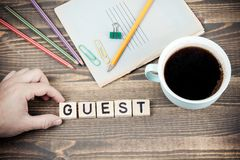 Guest. Wooden letters on the office desk royalty free stock photo