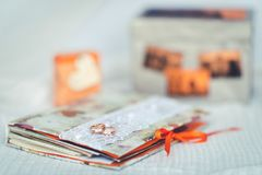 Wedding details. Guestbook and jewelery. Guestbook from greeting cards of wedding and golden wedding rings stock image