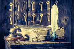 Guestbook and keys for rooms in old reception in hotel Stock Images