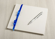 Guestbook with pen. Decorted wedding guestbook and the pen stock photos