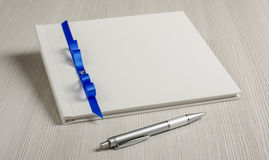 Guestbook and pen on the grey wood table. Wedding guestbook and the pen stock photo