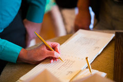 Guestbook Signing. Person signing the guestbook at a wedding ceremony and reception royalty free stock photography