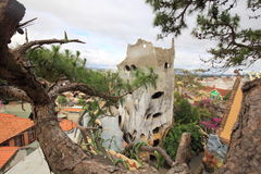 Guesthouse hang nga `Crazy house` in the Vietnamese city of Dalat. The complex of buildings of hotel custom surreal architecture combined with trees Stock Images