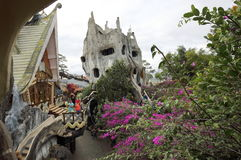 Guesthouse hang nga `Crazy house` in the Vietnamese city of Dalat. The complex of buildings of hotel custom surreal architecture combined with trees Royalty Free Stock Photo