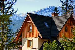 Guesthouse and mountain snowy landscape horizon Stock Photos