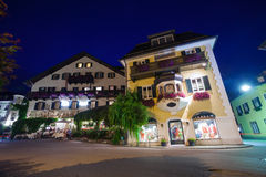 Guesthouses and motels at night in St. Gilgen Stock Image
