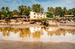 Guesthouses on the shore of the Arabian Sea in Ashvem, Goa Royalty Free Stock Image