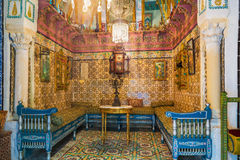The guestroom. SOUSSE, TUNISIA - SEPTEMBER 3, 2015: The hall for meeting guests and drinking tea decorated with old glazed tiles in Dar Essid mansion, on Stock Photography