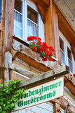 Guestrooms Sign on wooden board. Guest Rooms Sign on wooden board on a guest house in the Black Forest Royalty Free Stock Photography