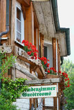 Guestrooms Sign on wooden board Stock Image