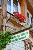 Guestrooms Sign on wooden board. Guest Rooms Sign on wooden board on a guest house in the Black Forest Royalty Free Stock Photos