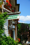 Guestrooms Sign on wooden board. Guest Rooms Sign on wooden board on a guest house in the Black Forest Stock Image