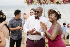 Guests at a beach wedding ceremony stock photography