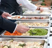 Guests at the buffet. Guests at a self-service buffet Royalty Free Stock Photo