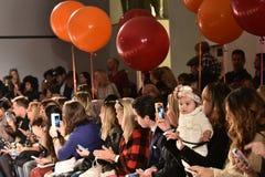 A guests crowd at Martin Morgan Fall/Winter 2016 Runway Show during petiteParade. NEW YORK, NY - OCTOBER 17: A guests crowd at Martin Morgan Fall/Winter 2016 stock photo