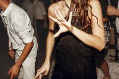 Guests dancing at wedding party. group of friends having fun at. Disco in light, motion moment. wedding reception in restaurant royalty free stock photo