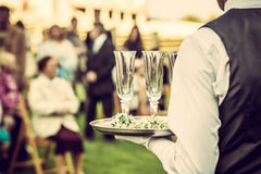 Guests drink champagne on the wedding ceremony Royalty Free Stock Photography