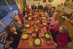 Guests at an elegant Thanksgiving dinner party Royalty Free Stock Images