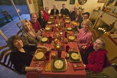 Guests at an elegant Thanksgiving dinner party Stock Image