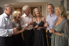 Guests Enjoying Champagne At Dinner Party