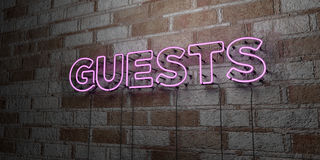 GUESTS - Glowing Neon Sign on stonework wall - 3D rendered royalty free stock illustration Royalty Free Stock Photo