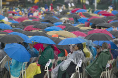 Guests hold umbrellas in the rain as they attend the official opening ceremony of the Clinton Presidential Library November 18, 20 Stock Photos