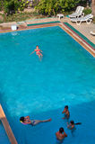 Guests of resort, swim in outdoor swimming pool, top view. Stock Images