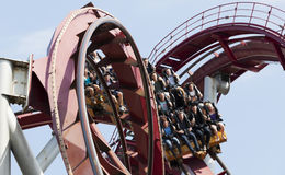 Guests on roller coaster ride in amusement park. Royalty Free Stock Photography