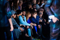 Guests of Slava Zaitsev catwalk at Spring-summer 2017 Mercedes- Benz Fashion Week Russia. MOSCOW, RUSSIA - OCTOBER 13, 2016: Guests of Slava Zaitsev catwalk at Royalty Free Stock Photo