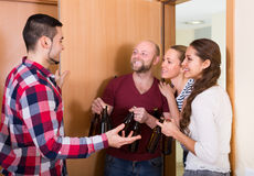 Guests standing in doorway Royalty Free Stock Image