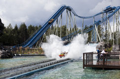 Guests on water ride in amusement park. Stock Photography
