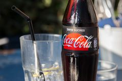 Guethary/France-28.07.18 : Glass bottle of Coca Cola sugar zero sugar free. Bottle of coca cola with a glasse with ice and lemon royalty free stock images