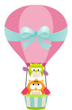 Gufi in una mongolfiera Fotografia Stock