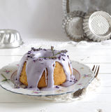 Gugelhupf with icing and lavender Royalty Free Stock Image