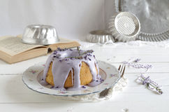 Gugelhupf with icing and lavender Royalty Free Stock Photography
