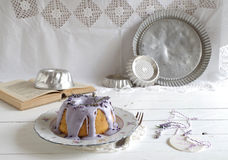 Gugelhupf with icing and lavender Stock Photography