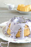 Gugelhupf with icing and lavender Royalty Free Stock Photos