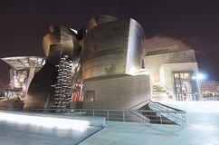Guggenheim. Bilbao, Biscay, Basque Country, Spain, July 30, 2011: night view of the  Guggenheim Museum at sunset. Guggenheim Museum is dedicated  exhibition of Royalty Free Stock Photo