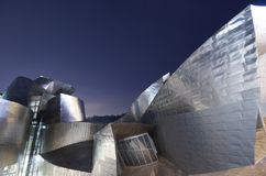 Guggenheim. Bilbao, Biscay, Basque Country, Spain, July 30, 2011: night view of the  Guggenheim Museum at sunset. Guggenheim Museum is dedicated  exhibition of Royalty Free Stock Photography