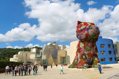 Guggenheim Bilbao. BILBAO, SPAIN - JULY 10, 2014: Flower Puppy in front of the famous Guggenheim Museum in the center of Bilbao, Basque country, Spain Royalty Free Stock Image