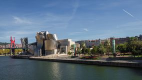 The Guggenheim Museum in Bilbao next to the river on a sunny day royalty free stock photography