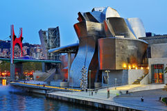 Guggenheim Museum in Bilbao, Spain. BILBAO, SPAIN - NOVEMBER 14: The Guggenheim Museum and the estuary at evening on November 14, 2012 in Bilbao, Spain. This Stock Photo