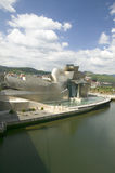 The Guggenheim Museum of Contemporary Art of Bilbao (Bilbo) on the river Ibaizabal, located on the North Coast of Spain in the Bas Stock Images