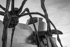 Statue of an Spider called Maman in Bilbao. The Guggenheim museum, Inaugurated on October 18,1997, is one of the biggest museums in Spain Royalty Free Stock Photo