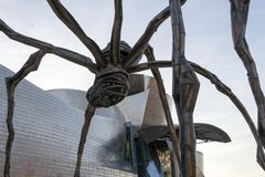 Statue of an Spider called Maman in Bilbao. The Guggenheim museum, Inaugurated on October 18,1997, is one of the biggest museums in Spain Royalty Free Stock Image