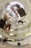 Guggenheim museum interior with Cattelans artwork, vertical. The New York Guggenheim Museum with Maurizio Cattelan artwork exhibit Stock Photography