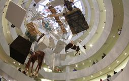 Guggenheim museum interior with Cattelans artwork, wide view. The New York Guggenheim Museum with Maurizio Cattelan artwork exhibit Royalty Free Stock Photo