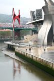 Guggenheim Museum and red bridge in Bilbao, Spain. The Guggenheim Museum Bilbao is a registered trademark and that any use, commercial or non-commercial, needs Royalty Free Stock Photos