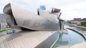 Guggenheim no.12. Facade of the Guggenheim museum in the Spanish city of Bilbao with the river Nervion beside Stock Images