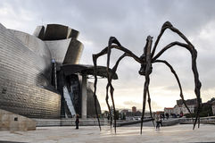 Guggenheim Spider. Giant bronze spider statue in Guggenheim Bilbao museum plaza Stock Photos